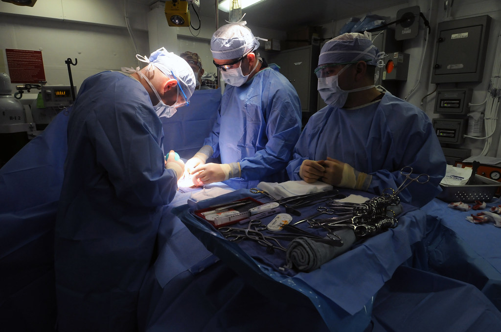 Navy doctors perform an umbilical hernia repair