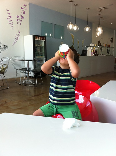 Finn enjoying the last of his frozen yogurt