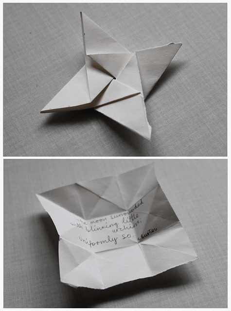 Paper poetry star illustrating Haiku 'Thoughts Hang Slack' by Heidi Burton