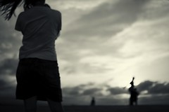 watching the sunset, Tottori, Japan (StephenCairns) Tags: trip family sunset summer vacation blackandwhite bw silhouette japan clouds crossprocessed wind spouse outoffocus wife   nocrop   manualfocus tottori oof  strongwind tottorisanddunes     30mmsigmaf14 canon50d stiffwind