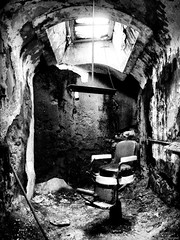 Barber Chair at Eastern State Penitentiary (mhoffman1) Tags: light bw haircut philadelphia chair pennsylvania cell prison pa barber jail nik philly disturbing fairmount penitentiary