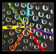 Colours of the rainbow (adrians_art) Tags: glass pencils reflections patterns abstracts waterdroplets
