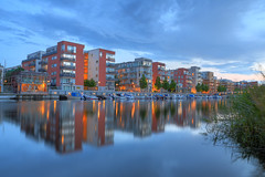 Sea City at Dusk III (Henrik Sundholm.) Tags: city bridge trees houses clouds buildings reflections boats construction sweden stockholm dusk sverige flagpole reef hdr kaj waterscape hammarby sickla sjstad