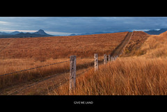 Give Me Land (itsgottabered) Tags: mountains grass canon fence landscapes country australia queensland fields sunburnt 1740l rosevale 5dmkii