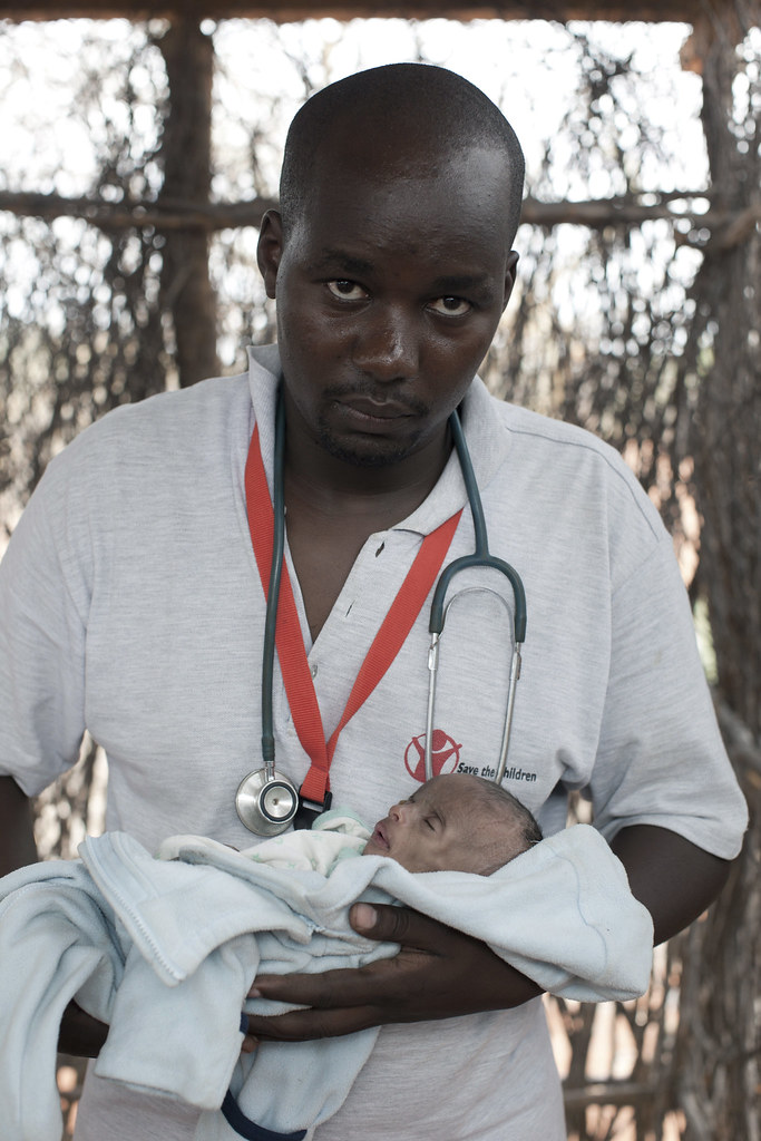 Umi, three months old, is examined by a by Daniel Wanyoike, the Community Therapeutic Nurse at a Save the Children outreach site in Kenya