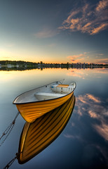 Orange II (- David Olsson -) Tags: sunset orange reflections boat nikon raw sundown sweden tripod sigma bluesky karlstad 1020mm polarizer hdr cpl chained vrmland cameraraw polarizingfilter lakescape photomatix marieberg orrholmen d5000 davidolsson alittleclouds