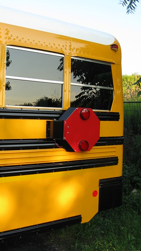 The rear flashing safety flag on a Bluebird school bus.  Glenview Illinois USA. August 2011. by Eddie from Chicago
