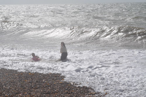 Two women nearly swept away by a wave on Brighton beach