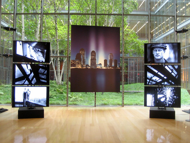 Large portrait of Tribute in Light and video screens