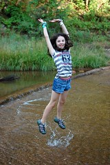 Megan loves to jump in the air and have me take her pictures (HIRH_MOM) Tags: 2001 family camping summer arizona hot smile smiling creek swimming fishing cabin august swing familyfun summerfun payson rainbowtrout familyvacation smilinggirls 2011 catchingfish riverfishing eastverderiver paysonarizona outdoorfun waterswing gilrshavingfun