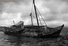 GHOST SHIP (michaeljohnsimages) Tags: voyage camera ireland shadow sea wild sky bw cloud seascape storm black seaweed cold classic beach wet water mystery clouds canon boats island mono boat photo interesting fishing cabin scenery rocks flickr alone ship photos decay transport picture wave location calm explore reflect journey sail sands float wreck chill trawler encounter discover monocrome blinkagain gettyimagesirelandq12012