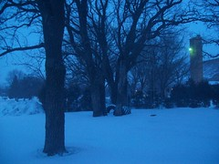 Winter twilight (disneyologist) Tags: blue winter light snow nature beautiful evening twilight afternoon streetlights deep pollution late magical