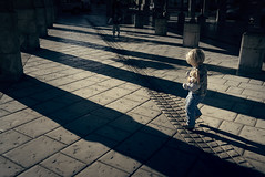 Under the marketplace (sparth) Tags: leica france girl silhouette walking kid europe shadows child place market cast marketplace doudou x1 castshadows brou calou leicax1