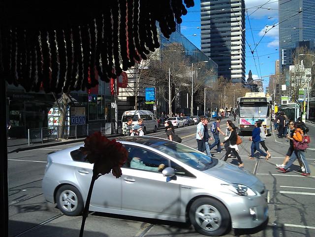 Restaurant tram passing Elizabeth Street