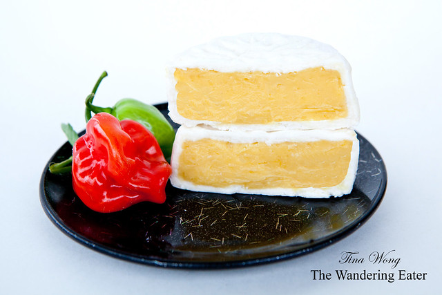 White (regular) snow skin filled with egg custard (lai wong; 奶黃)