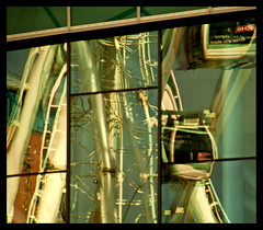 Reflecting the Wheel (Bruce Poole) Tags: windows light abstract reflection window glass lines wheel architecture liverpool mirror design waterfront northwest curves august ferris line ferriswheel conventioncentre merseyside 2011 liverpoolwheel worldtrekker echoarena brucepoole guardianportfoliorefelctionsbrucepoole