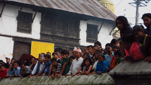 Onlookers watching the cremation, over the Bagmati River