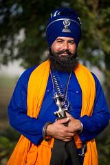 Leader of Generation Next (gurbir singh brar) Tags: blue portrait smile smiling training beard happy traditional sword glowing sikhs turban cheerful punjab radiant bana confident punjabi khalsa attire swordsman banga shastar nihangs dumala gurmatsangeetacademy gurbirsinghbrar nihangsingh savalakhfoundation shaheedbhagatsinghnagar pathlava babaswaranjitsingh