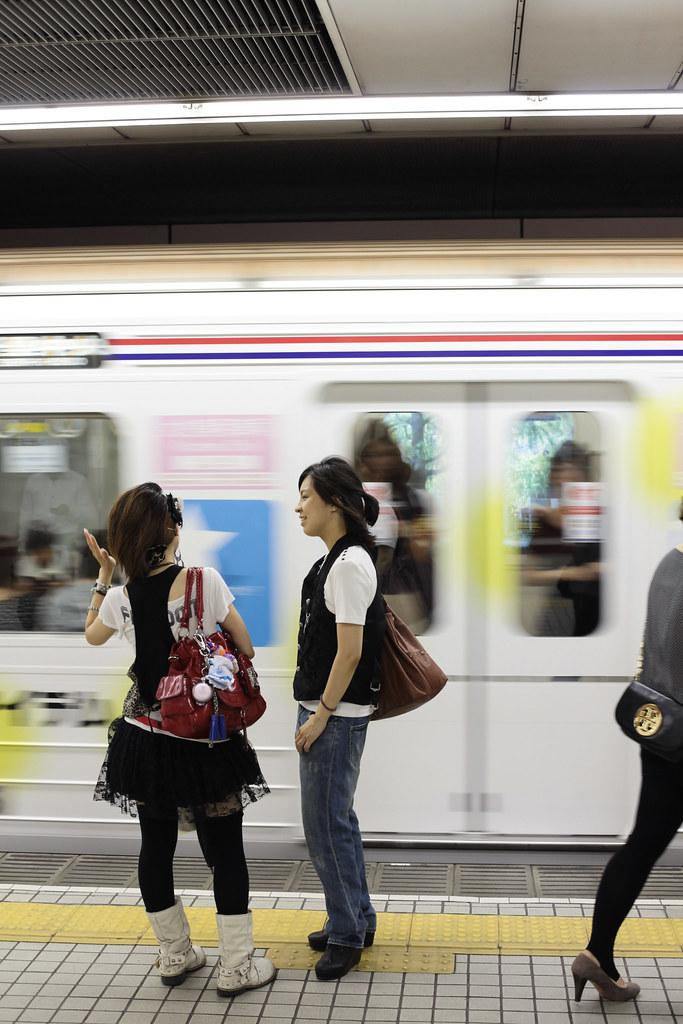 Girls talk in Osaka metro