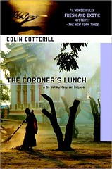 The cover of The Coroner's Lunch, which displays a photograph of a Laotian monk sweeping the ground near a temple