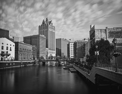 Old Milwaukee (Bruce Bordelon) Tags: city white motion black blur water skyline wisconsin clouds buildings river lens prime nikon focus long exposure downtown cityscape conversion 28mm smooth filter e milwaukee pro series sliver tall manual nikkor f28 riverwalk density neutral efex 10stop nd1000 d700