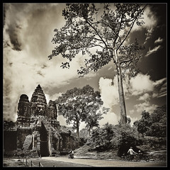 the mysterious world of the angkor..(explore, frontpage) (PNike (Prashanth Naik)) Tags: road sky people building tree sepia architecture temple ancient nikon asia cambodia gates entrance angkor wat motobike vertorama d7000 pnike yahoo:yourpictures=blackandwhite