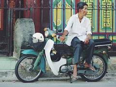 Waiting... (vieweronline) Tags: street river asia southeastasia delta vietnam motorbike motorcycle dailylife fareast mekong xeom motorbikedriver
