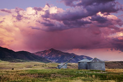Swan Valley Sunset (Daryl L. Hunter - The Hole Picture) Tags: pink sunset red farm east idaho grainery swanvalley derilict mtbaldy