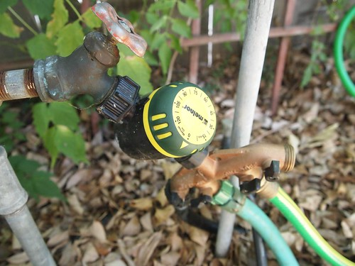 Soaker hose timer and manifold