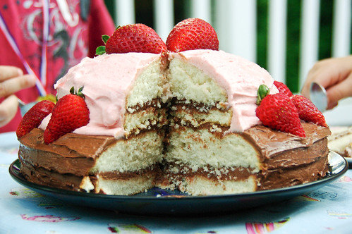 Quadruple layered vanilla cake with chocolate and fresh strawberry icing...