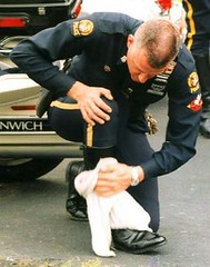 Cop polishing his boot! (TBTAOTW2011) Tags: cop police uniform leather black boots bootlick boot worship lick prisoner abuse domination humiliation academy men dominant shine polish