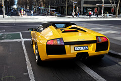Waiting for Green (Tom Fraser Photo) Tags: street city original red blackandwhite italy white man cars st yellow contrast digital train canon germany lago photography lights photo cool nice different image wheels 911 southyarra australia chapel aussie mad whoa collins exotics roadster murcielago aud contrasting carspotting spotter 550d carspot carspotter carspotters t0m722 aumurci