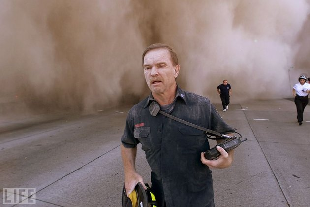 A firefighter runs from scene of 9/11