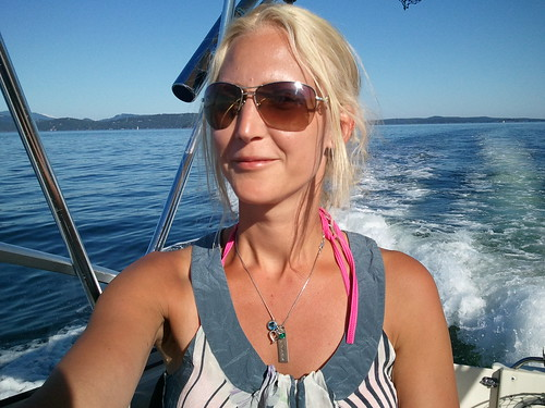 Sofia driving the boat. San Juan Islands. Aug 20, 2011.