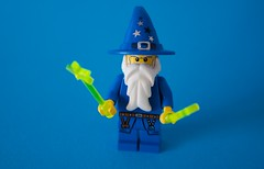 it's a wizarding world (jonoakley) Tags: lego wizard wizarding harry potter wand blue background wands minifigure mini fig figurine toy secret