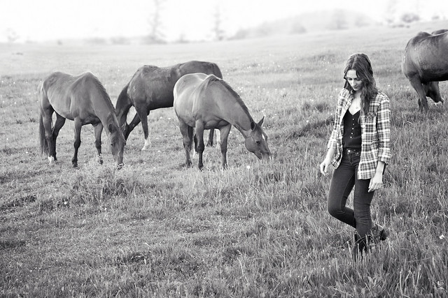 Black Mountain Colorado Dude Ranch woman walking horses
