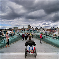 Always Alone (adrians_art) Tags: city sky people cloud london reflections walking shoes wheelchair structures tesco millenniumbridge disabled disability stpaulscatherdral