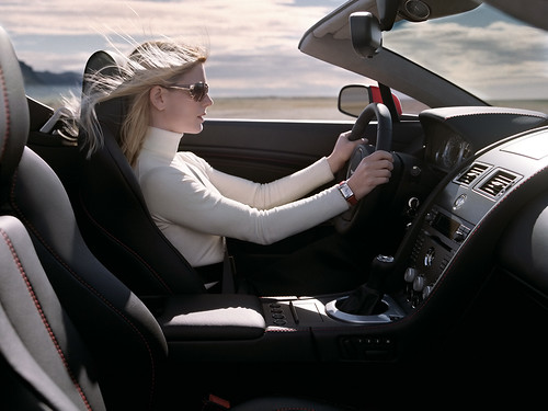 woman-driving-aston-martin-vantage-roadster