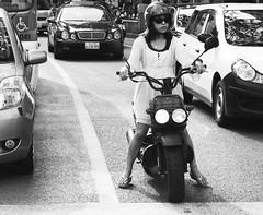 Stefan Hchst (It's Stefan) Tags: blackandwhite bw woman blancoynegro monochrome japan tokyo traffic noiretblanc shibuya scooter motorbike biancoenero   siyahvebeyaz schwazweis  monomonday stefanhchst