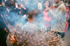 jeopardy (ouchelun) Tags: portrait people zeiss temple mood taiwan snap where fujifilm taipei moment 台灣 台北 g35 incense taoism 行天宮 contaxg2 道教 拜拜 hsintiankong