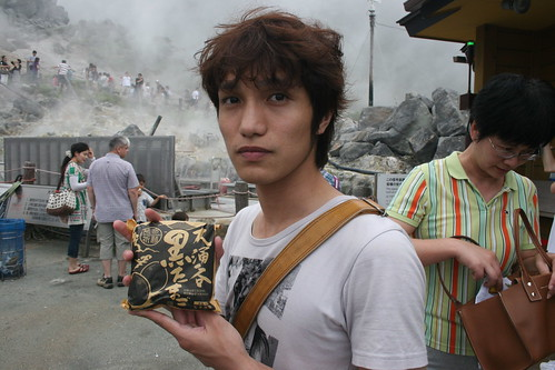 Tatsuya shows off the black egg package