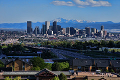 Snowcaps and Skylines (TIA International Photography) Tags: city urban terrain mountains building skyline skyscraper tia landscape spring high highway colorado downtown day apartments cityscape flat motorway state suburban centre capital may suburbia rocky peak center front denver capitol condo 25 level freeway pikes daytime suburb interstate plains broncos nuggets range condominium mile tosin thornton avalanche arasi tiascapes tiainternationalphotography