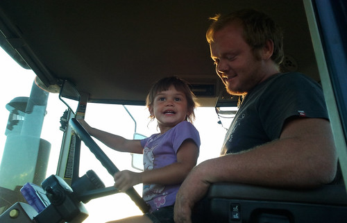Johan helps Kaidence drive the grain cart