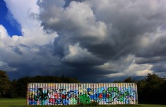People say graffiti is ugly, irresponsible and childish. But thats only if its done properly. (T-K-D) Tags: park storm clouds grafitti container hws banksyquote weekendshowcase yahoo:yourpictures=graffiti