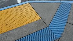 10656 / underfoot at stonestown (janeland) Tags: sanfrancisco blue yellow concrete grey parkinglot pavement geometry sidewalk curb underfoot stonestown 94132 urbandetailspool