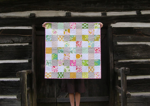 nicey jane baby quilt on the porch