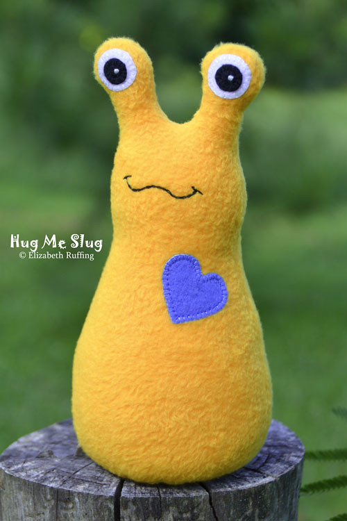 Gold fleece Hug Me Slug original art toy by Elizabeth Ruffing