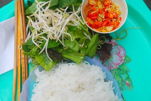 sticks, salad, noodles, chili