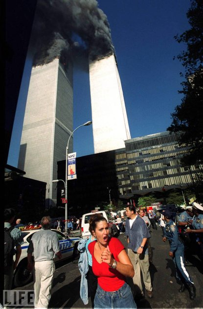 A woman running from 9/11 scene