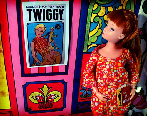 "Unhappy with her looks, a redhead Dollikin doll looks to modeling sensation Twiggy for ""thinspiration."""